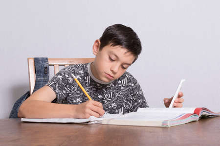 boy 12 year old: Young Boy Doing His Homework