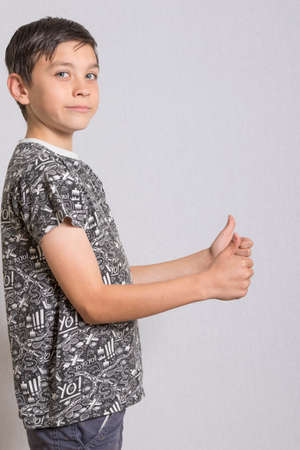 7 year old boys: Portrait of Young Boy With Thumbs Up Gesture Stock Photo