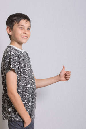 Portrait of Young Boy With Thumbs Up Gesture Stock Photo