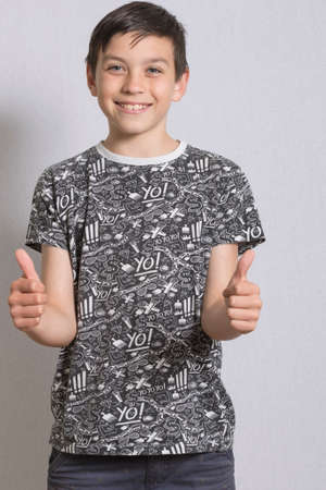 nine year old: Portrait of Young Boy With Thumbs Up Gesture Stock Photo