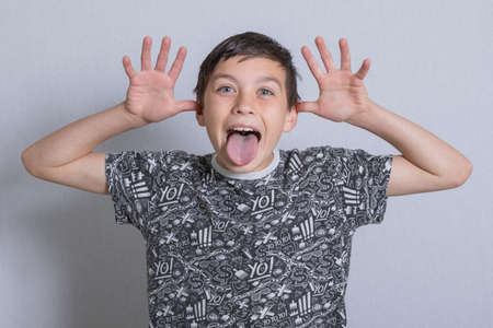 8   12: Portrait of a boy being silly Stock Photo