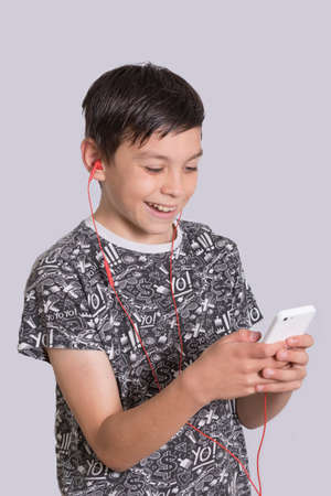 8 10 years: Young Boy Listening To Music With Headphones Stock Photo