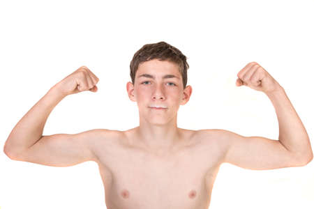muscle boy: Teen boy with milk moustache flexing his muscles Stock Photo