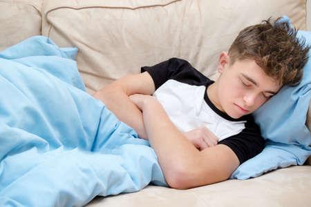 convalescing: Teenage Boy Asleep on A Sofa