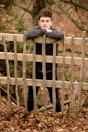 lean out: Teenage Boy Leaning On A Fence