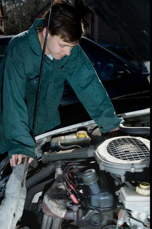 16 17 years: Teenage Boy Looking At A Car Engine
