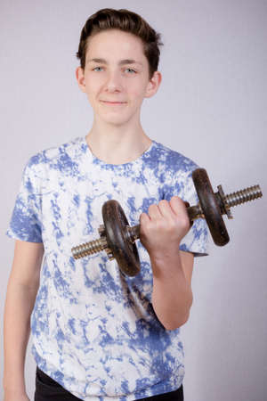 14 15 years: Teenage Boy Doing Strength Training Stock Photo