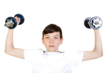 Young boy lifting a pair of dumbbells
