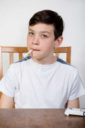 Young boy with cigarette in his mouth