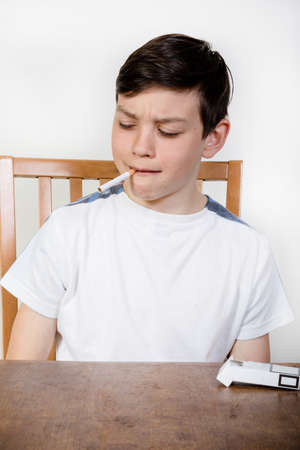 Young boy with a cigarette in his mouth