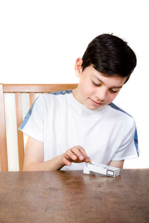 fag: Young boy taking a cigarette from a packet