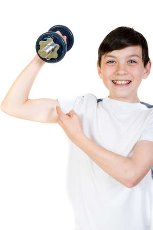 12 13: Happy boy lifting a dumbbell pointing at his bicep Stock Photo