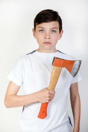 12 13: Young boy holding an axe Stock Photo