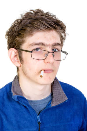 boy 16 year old: Teenage boy with a cigarette in his mouth