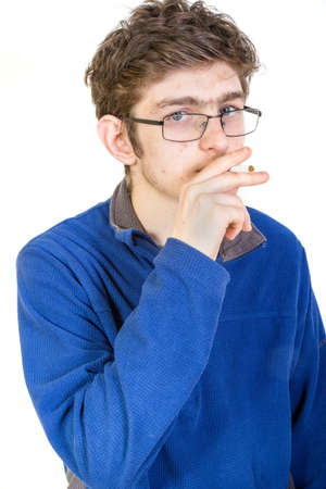 boy 15 year old: Teenage boy with cigarette in his mouth