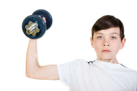 12 13: Young boy lifting a dumbbell
