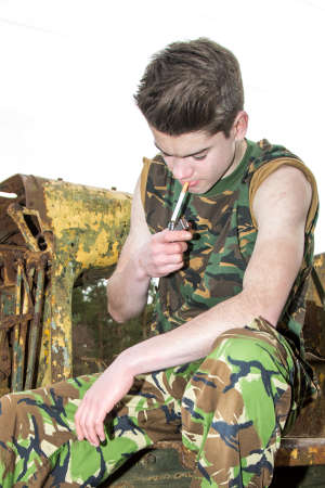 14 15 years: Teenage cadet lighting a cigarette