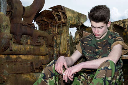 14 15 years: Sad teenage cadet with cigarettes Stock Photo
