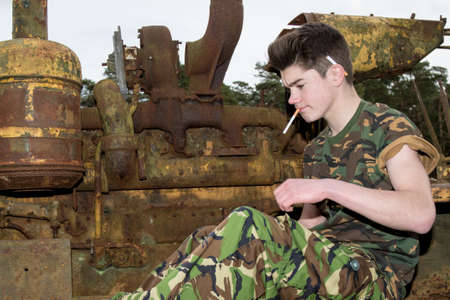 14 15 years: Teenage cadet with a cigarette
