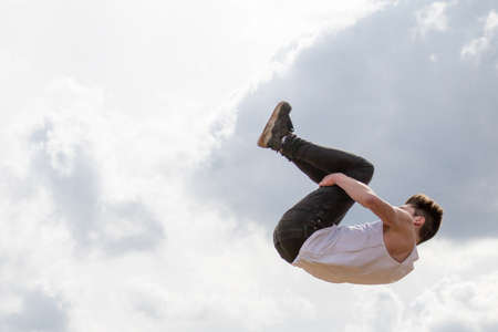 somersault: Teenage boy doing a somersault