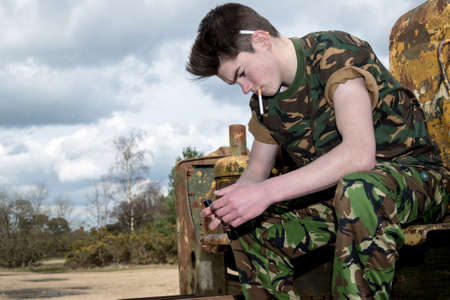14 15 years: Teenage cadet about to smoke a cigarette