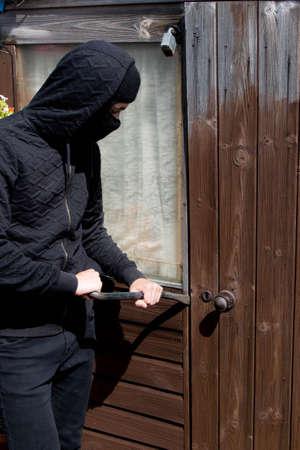 breaking: Burglar breaking and entering