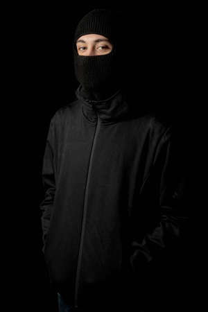 Man wearing a balaclava Stock Photo