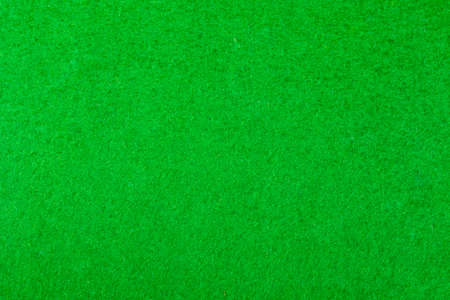 Green felt of a card table