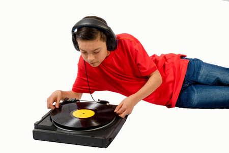 Teenage boy putting a LP on a player