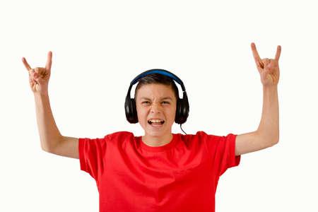 Teenage boy making rock n roll hand gesture