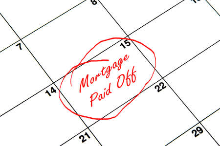 Mortgage Paid Off Circled on A Calendar in Red Archivio Fotografico
