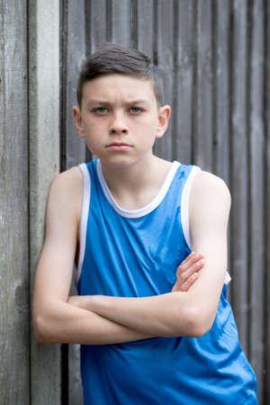 Teenage boy outside with a skateboard Stock Photo