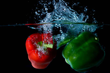 vegtables: Green & Red Bell Sweet Peppers Droped Into Water