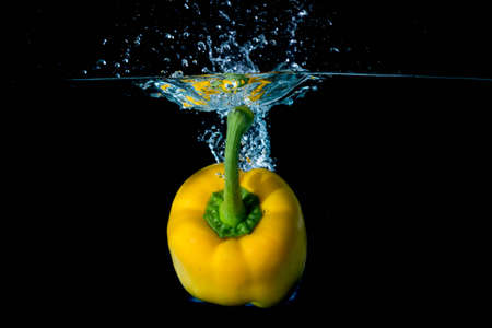 vegtables: Yellow Bell Sweet Pepper Droped Into Water
