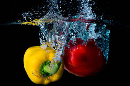 vegtables: Yellow & Red Bell Sweet Peppers Droped Into Water