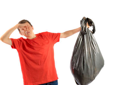 Young teenage boy isolated on a white background with smelly rubbish Stock Photo