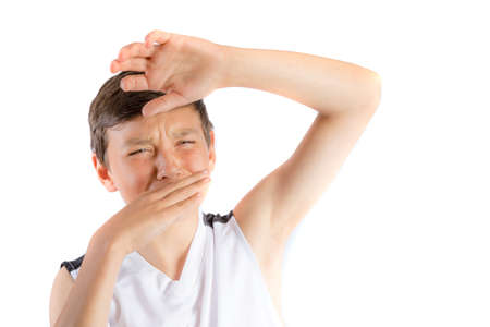 Young teenage boy isolated on a white background with smelly armpit