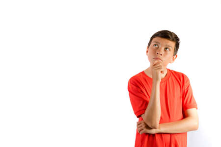 Young teenage boy isolated on white thinking