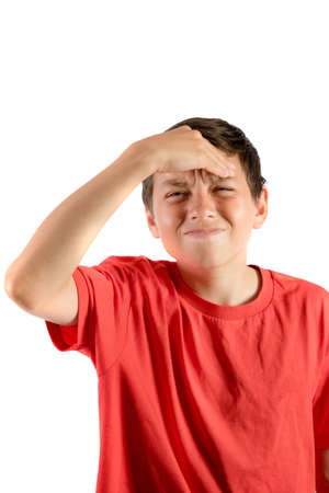 A young teenage boy isolated against white background with a migraine