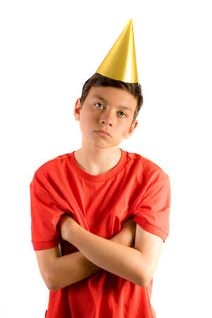 Young teenage boy isolated on white looking annoyed at a party Stock Photo