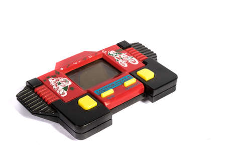 Retro handheld personal video game isolated on a white background Editorial