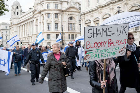 4th November 2017, London, United Kingdom:-Pro Palestine protesters march infront of Pro Israeli marchers