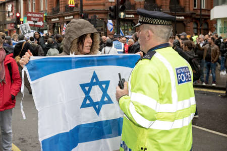 4th November 2017, London, United Kingdom:-Pro Israeli protester confronts a metropolitan police officer at a pro Palestine rally Editorial