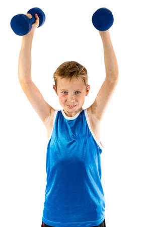 pre teen boy: Pre-teen boy lifting weights isolated on a white background Stock Photo
