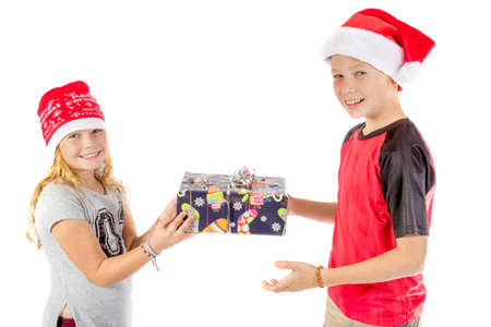 Siblings exchange a christmas present isolated on white background Stock Photo