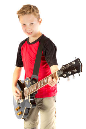 Pre-teen boy and an electric guitar isolated on white background Stock Photo