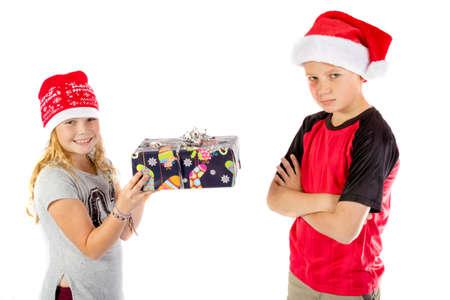 Grumpy boy given a christmas present
