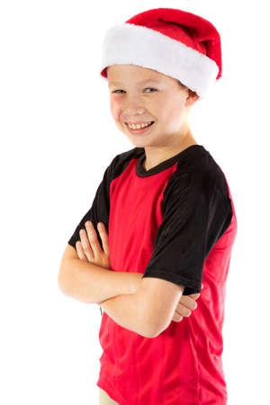 Pre-teen boy wearing a santa hat looiking happy isolated on white