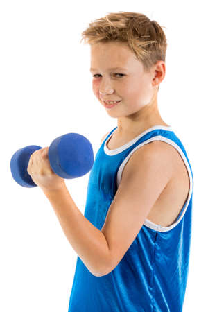 Pre-teen boy lifting weights isolated on a white background Stock Photo