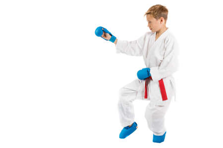 pre teen boy: Pre-teen boy doing karate on a white background